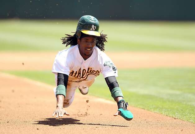 OAKLAND, CA - MAY 09:  Jemile Weeks #19 of the Oakland Athletics steals third base in the first inning outfield their game against the Toronto Blue Jays at O.co Coliseum on May 9, 2012 in Oakland, California.  (Photo by Ezra Shaw/Getty Images) Photo: Ezra Shaw, Getty Images