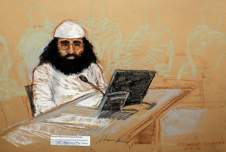 In this photo of a sketch by courtroom artist Janet Hamlin and reviewed by the U.S. Department of Defense, accused Sept. 11 co-conspirator Walid bin Attash is shown while attending his military hearing at the Guantanamo Bay U.S. Naval Base in Cuba, Saturday, May 5, 2012. Khalid Sheikh Mohammed, the self-proclaimed mastermind of the Sept. 11 attacks repeatedly declined to respond to a judge's questions Saturday and Walid bin Attash was briefly restrained at a military hearing as five men, including Khalid Sheikh Mohammed and Walid bin Attash, were charged with the worst terror attack in U.S. history. (AP Photo/Janet Hamlin, Pool) Photo: Janet Hamlin, Associated Press