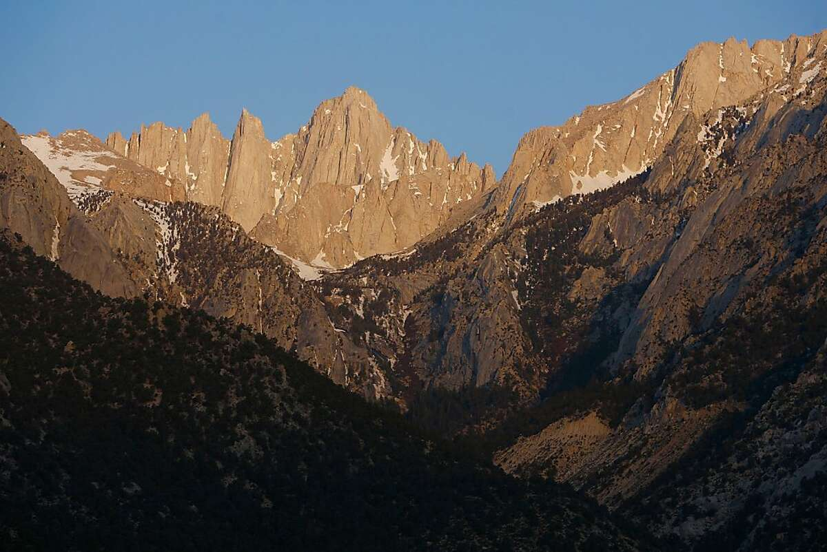 Mount Whitney, the tallest peak in the continental US at 14,494 feet, stands in the Sierra Nevada Mountains, which carry less snow than normal in 2008. The Sierra snowpack is vital to California water supplies.