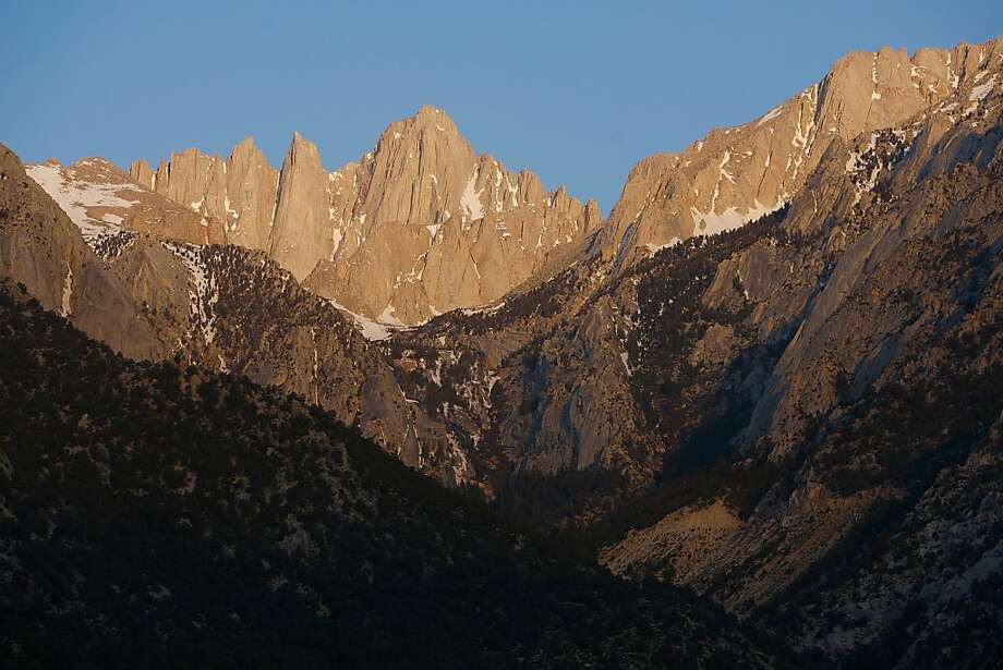 Mount Whitney, the tallest peak in the continental US at 14,494 feet, stands in the Sierra Nevada Mountains, which carry less snow than normal in 2008.  The Sierra snowpack is vital to California water supplies. Photo: David McNew, Getty Images
