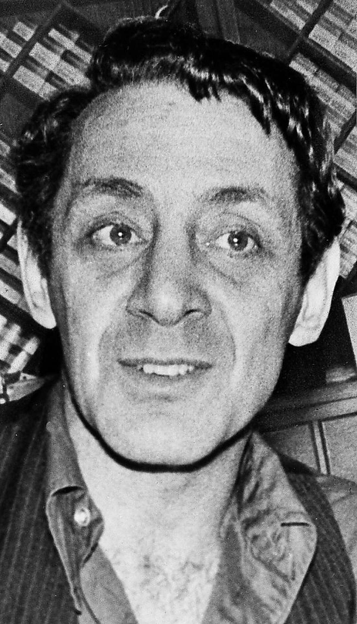 In this June 28, 1977 black-and-white file photo, Harvey Milk, a gay political leader in San Francisco, is seen pictured in his camera store on Castro Street in San Francisco. President Barack Obama will recognize the accomplishments of actors, activists and athletes on Wednesday when he awards the Presidential Medal of Freedom to 16 people. (AP Photo, FILE)