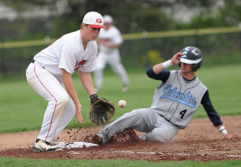 Columbia's Erik Martin is safe at third base as Guilderland's Joe Bender doesn't get the throw in ti