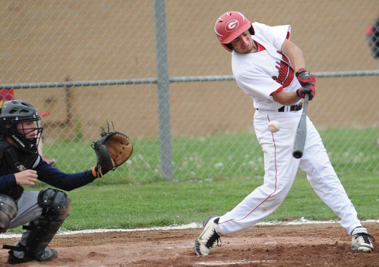 Guilderland's Devin Fisher swings for the ball during a baseball game against Columbia Wednesday, Ma