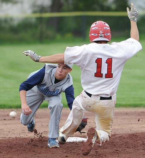 Guilderland's Mike Doynow is safe at second base as Columbia's Tyler Casavant loses the ball during