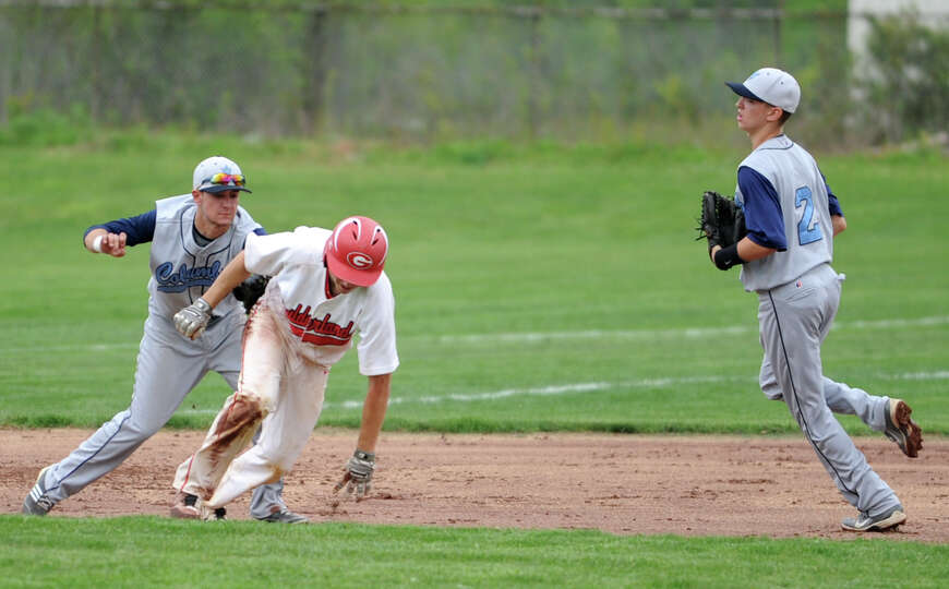 Guilderland's Mike Doynow gets tagged out in a pickle between second and third base with Columbia's