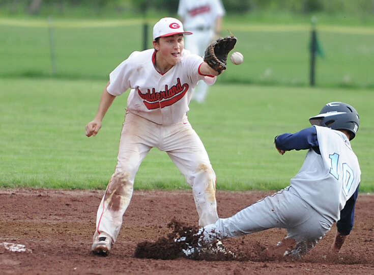 Columbia's Tyler Casavant is safe at second base as Guilderland's Mike Doynow doesn't get the tag do