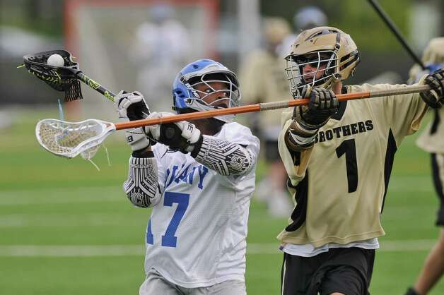 Albany Lacrosse Modified Team player Dejeir Coleman, left,  during their game against CBA on Monday May 7, 2012 in Albany, NY.  CBA's Kyran Nigro is at right.  (Philip Kamrass / Times Union ) Photo: Philip Kamrass / 00017566A