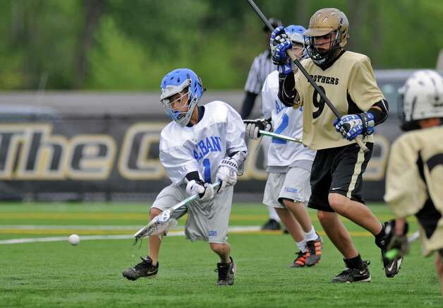 Albany Lacrosse Modified Team player Kyle Pearlman, left,  chases the ball during their game against CBA on Monday May 7, 2012 in Albany, NY.  CBA's Gabe Bernier is at right.  (Philip Kamrass / Times Union ) Photo: Philip Kamrass / 00017566A