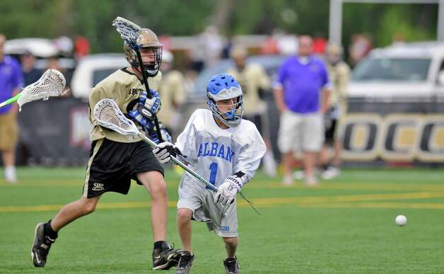 Albany Lacrosse Modified Team player Kyle Pearlman, right,  chases the ball during their game against CBA on Monday May 7, 2012 in Albany, NY.   (Philip Kamrass / Times Union ) Photo: Philip Kamrass / 00017566A
