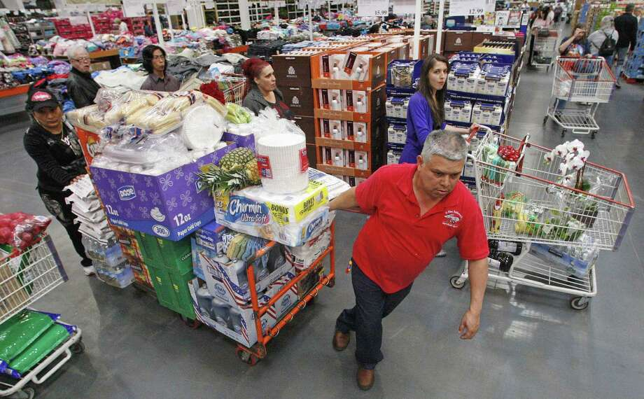 Antonio Moreno shops at a Costco Wholesale store Wednesday, May 9, 2012, in Portland, Ore. The Commerce Department said Wednesday, May 9, 2012, that wholesale stockpiles increased 0.3 percent in March, just one-third of the 0.9 percent rise in February. Sales in March were up 0.5 percent, about half the 1.1 percent sales gain in February. (AP Photo/Rick Bowmer) Photo: Rick Bowmer