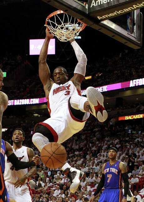 Miami's Dwyane Wade flushes for two of his 19 points. Photo: Marc Serota, Getty Images / 2012 Getty Images