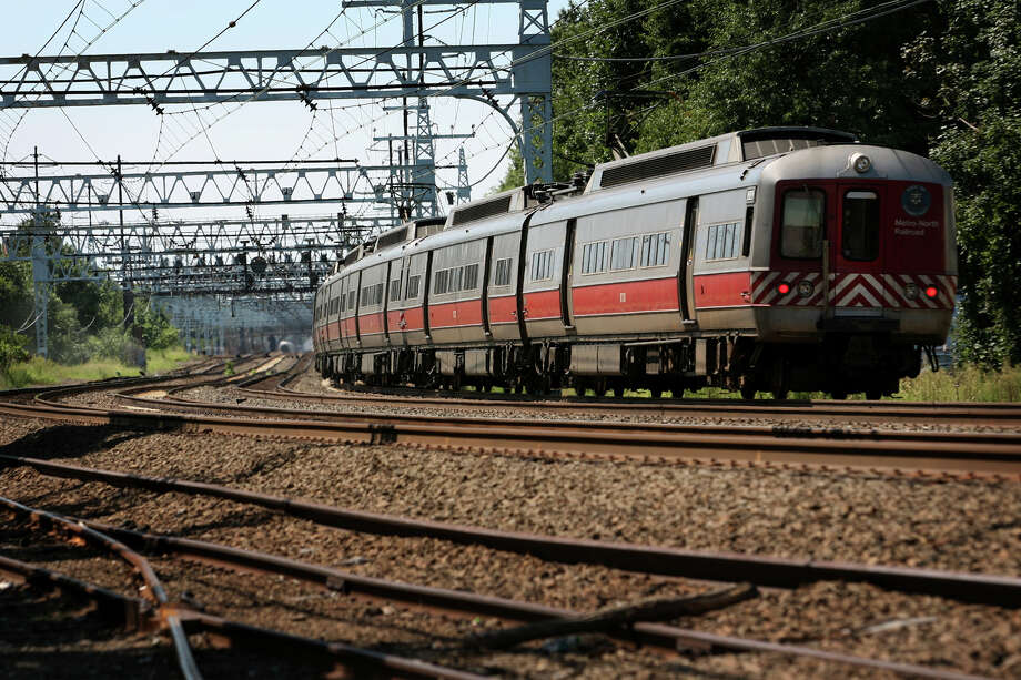 A Metro North train heads down the tracks near the Stratford/Bridgeport line in Conn. Photo: File Photo / Connecticut Post File Photo