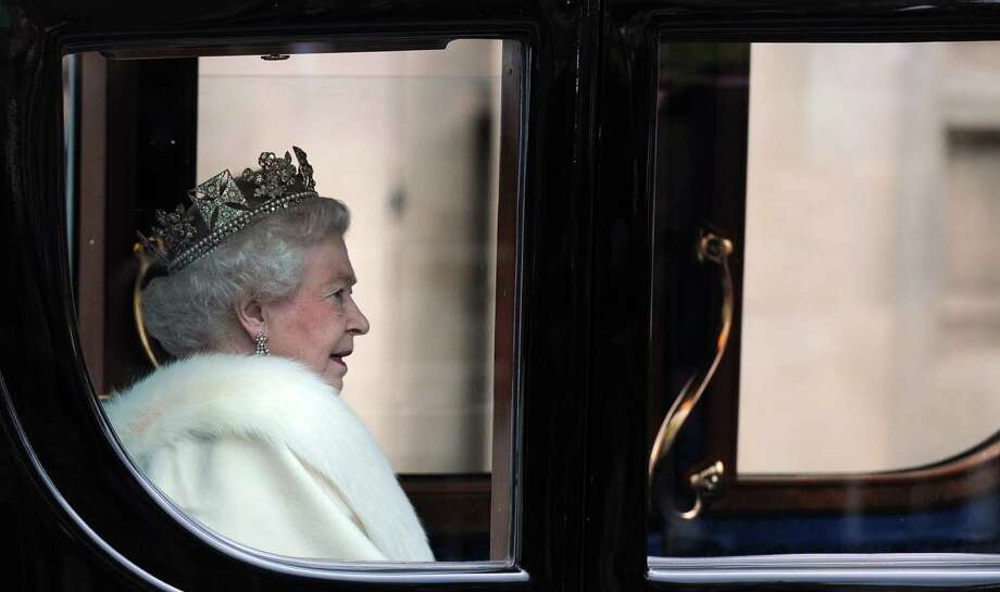 Britain's Queen Elizabeth II arrives in the Australian State Coach at the Palace of Westminster for the State Opening of Parliament in London on May 9, 2012.  Britain's Queen Elizabeth II unveiled the coalition government's legislative programme in a speech delivered to Members of Parliament and Peers in the House of Lords. Photo: CARL COURT, AFP/Getty Images / AFP