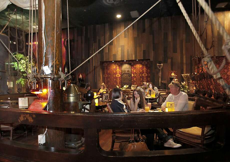 Diners at the Tonga Room sit in booths beneath ships rigging, statues and sails Wednesday May 19, 2010. The Tonga Room in the Fairmont Hotel in San Francisco, Calif. will be considered for historical landmark status by the City Historical Review Committee. Photo: Brant Ward, The Chronicle