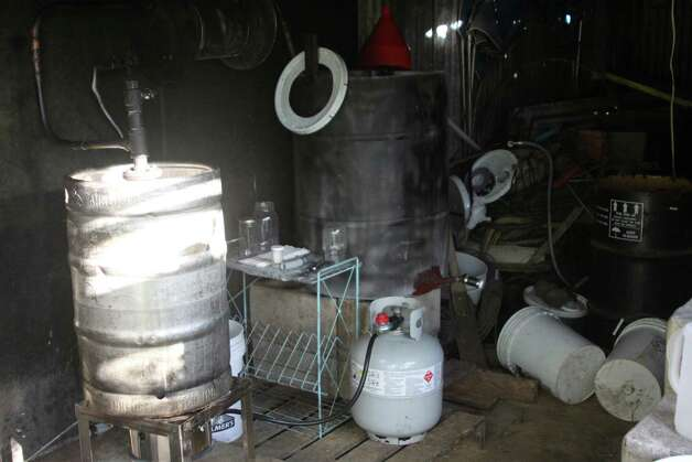 The Hardin County Sheriff's Office confiscated a moonshine still from a home on Harper Lane in Kountze Wednesday evening. Two were arrested and charged one count of possession of illicit distilled spirits and one count of possession of material of manufacture for illicit beverage. Photo: David Lisenby