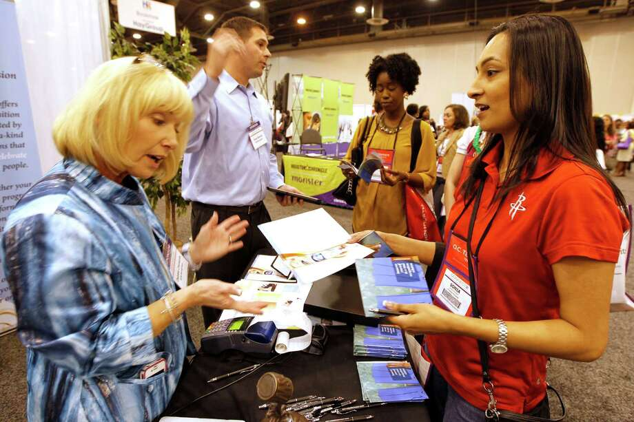 Debbie Clements, left, and Vince Bonura of MTM Recognition speak with Houston Rockets official Sonia Christian, right, and Charming Charlie's Brittany Smith at a human resources event. Photo: James Nielsen / © Houston Chronicle 2012