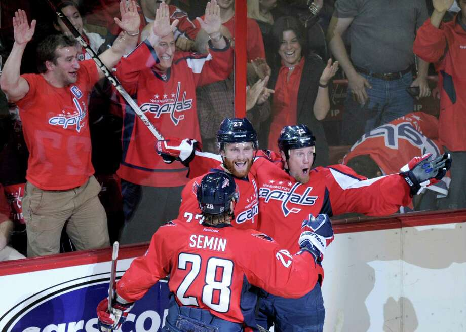 Washington Capitals left wing Jason Chimera, right, celebrates a goal against the New York Ranger with teammates defenseman Karl Alzner, center, and left wing Alexander Semin (28) in the second period of Game 6 of a second-round NHL hockey Stanley Cup playoff series in Washington, Wednesday, May 9, 2012. The Capitals defeated the Rangers 2-1. (AP Photo/Susan Walsh) Photo: Susan Walsh
