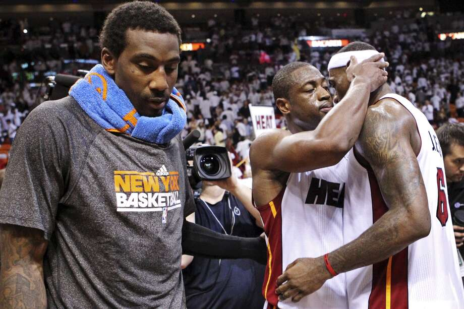 Miami Heat guard Dwyane Wade, second from right, and forward LeBron James, right, embrace as New York Knicks forward Amare Stoudemire walks off the court following an NBA basketball game in the first round of the Eastern Conference playoffs, Wednesday, May 9, 2012, in Miami. The Heat won 106-94 to win the series 4-1 and advance to the second round. (AP Photo/The Miami Herald, Al Diaz)  MAGS OUT Photo: Al Diaz