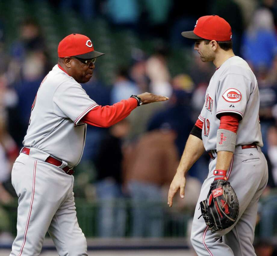 Reds manager Dusty Baker (left) got his 1,500th win Wednesday. Photo: AP