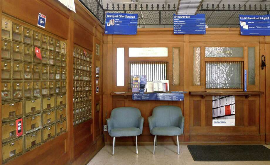 This Saturday, Sept. 17, 2011 photo shows the local post office in Markham, Va. The financially struggling U.S. Postal Service sought Wednesday, May 9, 2012 to tamp down concern over wide-scale cuts, revealing it will seek to keep thousands of rural post offices open with shorter hours. Under the emerging strategy, no post office would be closed. But more than 13,000 rural mail facilities could see reduced operations of between two and six hours. (AP Photo/J. Scott Applewhite) Photo: J. Scott Applewhite