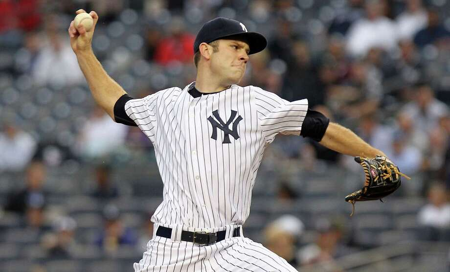 NEW YORK, NY - MAY 09:  David Phelps #41 of the New York Yankees pitches against the Tampa Bay Rays at Yankee Stadium on May 9, 2012 in the Bronx borough of New York City.  (Photo by Nick Laham/Getty Images) Photo: Nick Laham