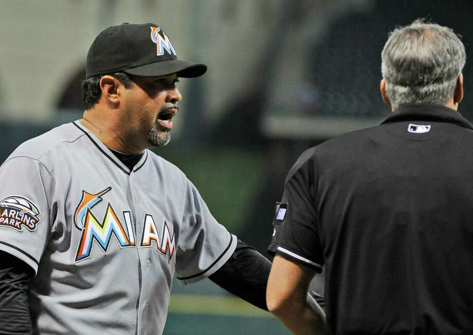 Marlins manager Ozzie Guillen has words with home plate umpire Tim Timmons in the seventh inning. Photo: AP
