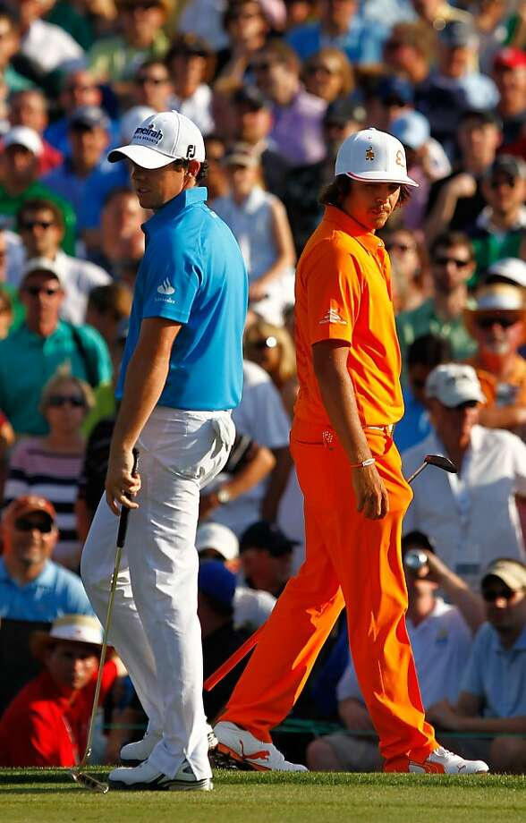 CHARLOTTE, NC - MAY 06:  Rickie Fowler (R) of the United States and Rory McIlroy (L) of Northern Ireland stand on the green of the first playoff hole during the final round of the Wells Fargo Championship at the Quail Hollow Club on May 6, 2012 in Charlotte, North Carolina.  (Photo by Streeter Lecka/Getty Images) Photo: Streeter Lecka, Getty Images