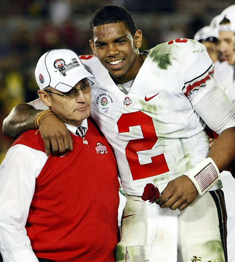 FILE- This Jan. 1, 2010, file photo shows former Ohio State head coach Jim Tressel, left, and then MVP Terrelle Pryor celebrating after winning the Rose Bowl NCAA college football game against Oregon in Pasadena, Calif. A stormy offseason cost Ohio Statecoach Tressel and quarterback Pryor, and could lead to NCAA sanctions. Neither Ohio State nor Michigan, the teams that have combined to win 77 Big Ten titles, are even favored to win their divisions this season. Photo: Mark J. Terrill, AP
