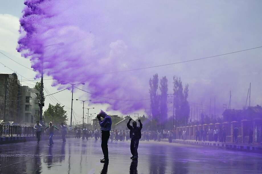 TOPSHOTS  Kashmiri government employees are sprayed with purple colored water by Indian police to disperse a protest in Srinagar on May 9,, 2012. Indian police detained dozens of government employees, used water cannons and resorted to baton charging the employees during the protest. The government employees were demanding an increase in the retirement age from 58 to 60 and the release of arrears. AFP PHOTO/Tauseef MUSTAFATAUSEEF MUSTAFA/AFP/GettyImages Photo: Tauseef Mustafa, AFP/Getty Images