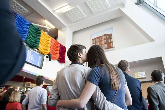 At the San Francisco Lesbian Gay Bisexual Transgender Community Center, Emma Mishel (left) and her partner, Madelein McCormick, embrace during a toast celebrating President Obama's announcement that he supports same-sex marriage. Photo: Jason Henry, Special To The Chronicle