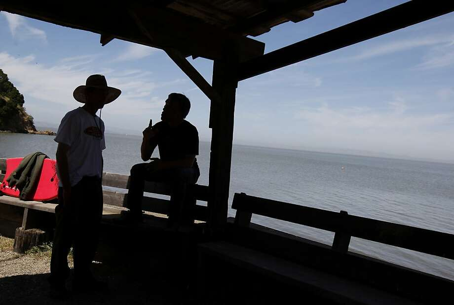 Matthew Calkins (left) and Ernest Chung talk at China Camp with the San Francisco bay in the background. California State Senator Joe Simitian has unveiled a plan to save state parks including the popular China Camp State Park in Marin County, Calif. Photo: Brant Ward, The Chronicle