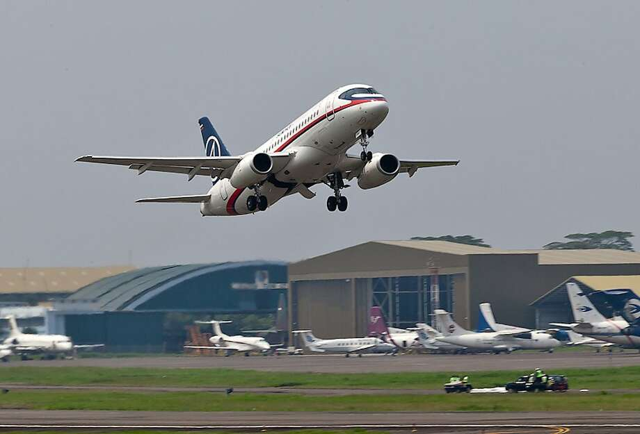In this photo released by Sergey Dolya, a Sukhoi Superjet-100 takes off from Halim Perdanakusuma airport in Jakarta, Indonesia, Wednesday, May 9, 2012 on it's second demonstration flight of the day. The Russian-made Sukhoi jet plane with 50 people on board, including eight Russians and an American, has gone missing during this flight near Jakarta, Indonesian government officials said Wednesday.(AP Photo/Sergey Dolya) NO SALES Photo: Sergey Dolya, Associated Press