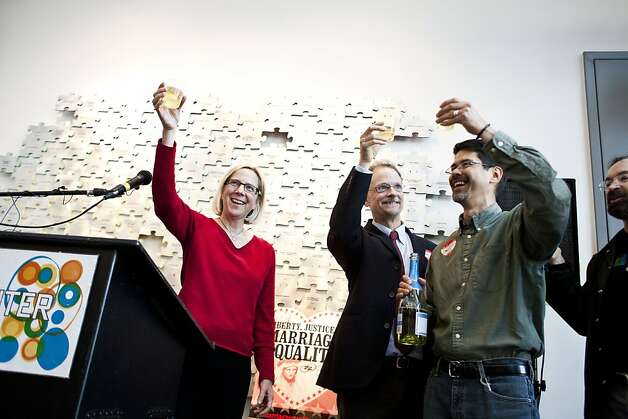 Rebecca Wolfe, John Lewis of Marriage Equality USA and his partner, Stuart Gaffney, toast the president's announcement at the San Francisco Gay Bisexual Transgender Community Center. Photo: Jason Henry, Special To The Chronicle