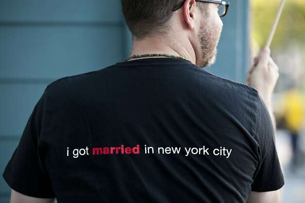 Brandon Brock wears a shirt commemorating his marriage to his partner in New York City during a rally celebrating Obama's announcement that he supports gay marriage at the San Francisco Lesbian Gay Bisexual Transgender Community Center in San Francisco, Calif., May 9, 2012. Jason Henry/Special to The Chronicle Photo: Jason Henry, Special To The Chronicle