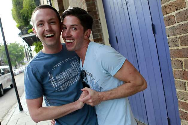 David Peters, right, and Luke Whited, a gay couple who are joined in a civil union in their home state of Illinois, pose for the camera prior to being interviewed  about President Obama's statement of support of gay marriage, in New Orleans, Wednesday, May 9, 2012. Ending months of equivocation, Obama declared his support for gay marriage, the first U.S. president to do so. His announcement, a day after North Carolina conservatives turned out in force to vote to strengthen the state's gay marriage ban, injects a potentially polarizing issue into the 2012 race for the White House. (AP Photo/Gerald Herbert) Photo: Gerald Herbert, Associated Press