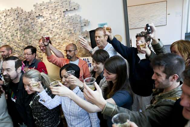 Members of the LGBT community and other community members make a toast celebrating Obama's announcement that he supports gay marriage at the San Francisco Lesbian Gay Bisexual Transgender Community Center in San Francisco, Calif., May 10, 2012. Photo: Jason Henry, Special To The Chronicle