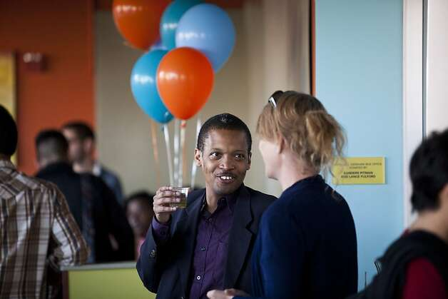 Kevin Bard and Jamie Rafaela Wolfe sip champagne during a celebration of Obama's stance on marriage equality at the San Francisco Lesbian Gay Bisexual Transgender Community Center in San Francisco, Calif., May 9, 2012. Photo: Jason Henry, Special To The Chronicle