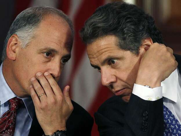 Larry Schwartz, left, secretary to the governor, talks to New York Gov. Andrew Cuomo during a cabinet meeting in the Red Rom at the Capitol in Albany, N.Y., on Wednesday, May 9, 2012. Cuomo says he didn't discuss the effort to legalize gay marriage during his private conversations with President Obama on Tuesday, and doesn't intend to push it. (AP Photo/Mike Groll) Photo: Mike Groll, Associated Press