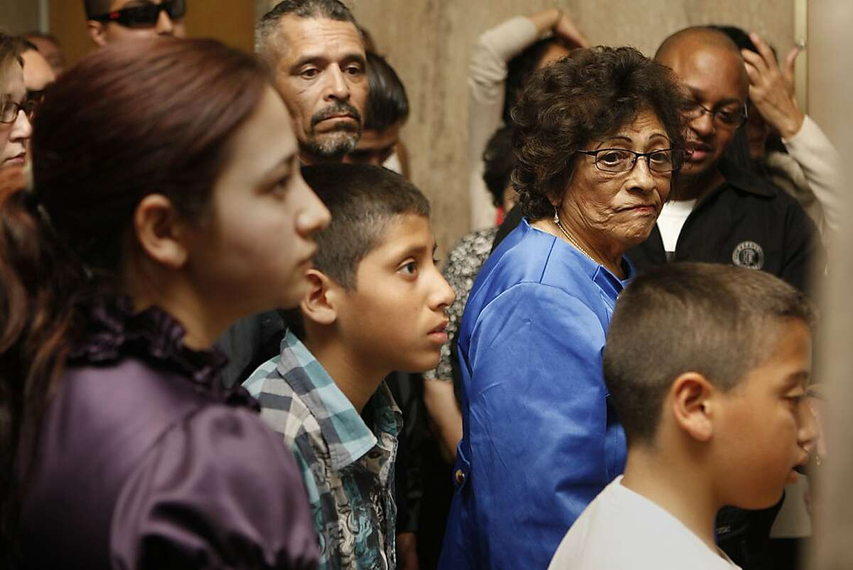 Danielle Bologna's mother (in blue) waits to enter the courtroom with friends and family at the Hall of Justice in San Francisco, Calif., to hear the jury's verdict on Wednesday, May 10, 2012. Edwin Ramos, 25, was convicted today of the mistaken-identity murders of a San Francisco father and his two sons.