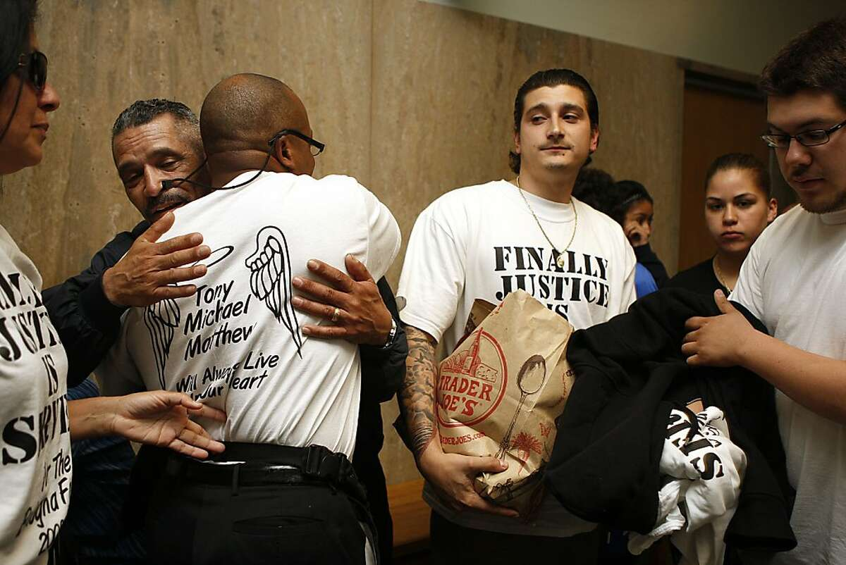 Friends of the Bologna family Reggie Hamilton (left) and Maverick Bishop (middle, right) don their shirts at the Hall of Justice in San Francisco, Calif., after the Ramos verdict on Wednesday, May 10, 2012. Edwin Ramos, 25, was convicted today of the mistaken-identity murders of her San Francisco husband and his two sons.
