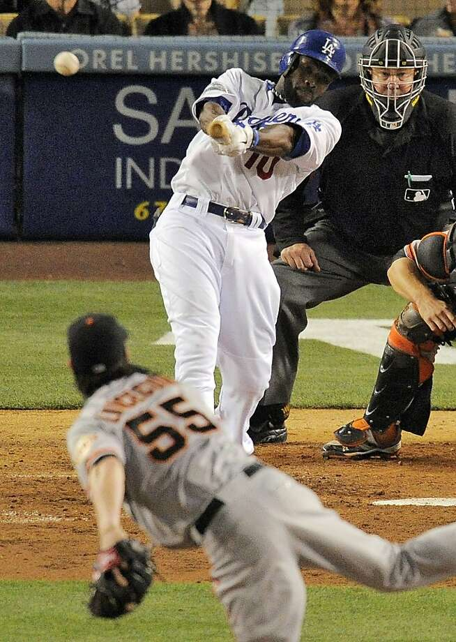 Los Angeles Dodgers' Tony Gwynn swings on a three-run triple off San Francisco Giants starting pitcher Tim Lincecum during the fourth inning of a baseball game, Wednesday, May 9, 2012, in Los Angeles. (AP Photo/Mark J. Terrill) Photo: Mark J. Terrill, Associated Press