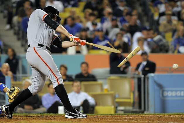 San Francisco Giants' Brandon Belt breaks his bat as he grounds out during the seventh inning of their baseball game against the Los Angeles Dodgers, Wednesday, May 9, 2012, in Los Angeles. (AP Photo/Mark J. Terrill) Photo: Mark J. Terrill, Associated Press