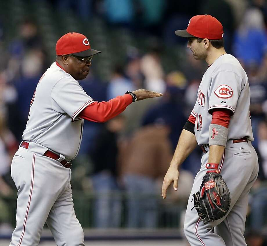 Cincinnati Reds manager Dusty Baker, left, congratulates Joey Votto after their 2-1 win in a  baseball game against the Milwaukee Brewers, Wednesday, May 9, 2012, in Milwaukee. (AP Photo/Morry Gash) Photo: Morry Gash, Associated Press