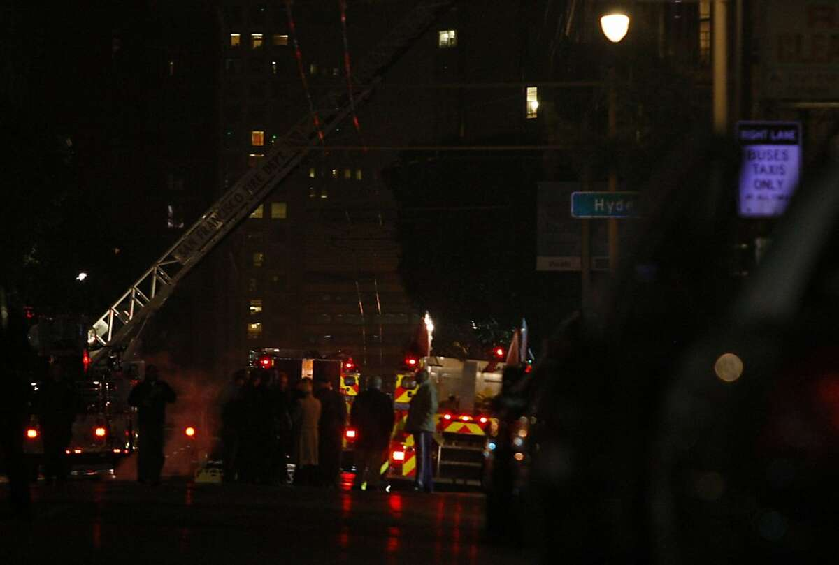 Attempts being made to capture a man shooting a gun in a building on Polk at Leavenworth streets in San Francisco, Calif., on Wednesday night, May 9, 2012.