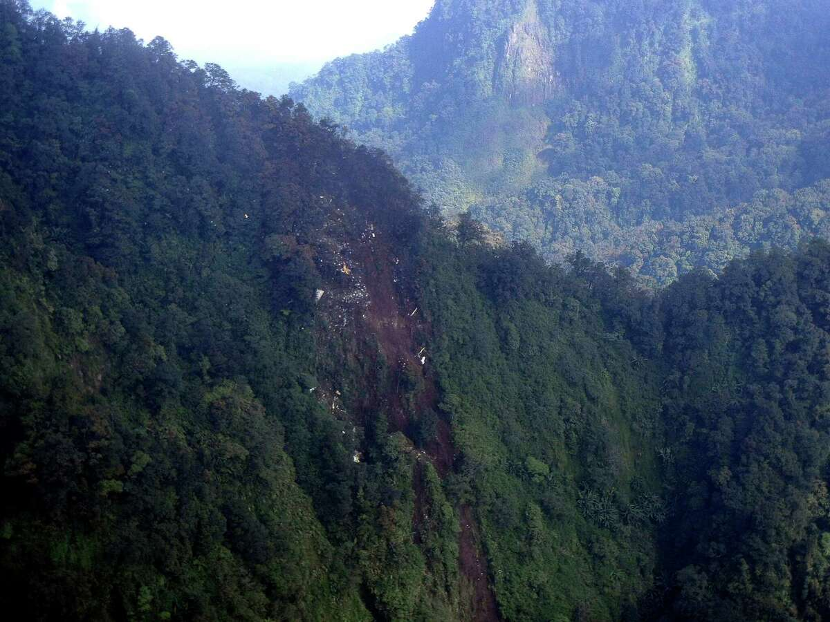 In this photo released by Indonesian Air Force, the wreckage of a missing Sukhoi Superjet-100 are scattered on the mountainside in Bogor, West Java, Indonesia, Thursday. The new Russian-made passenger plane disappeared Wednesday during a demonstration flight with 47 people on board.