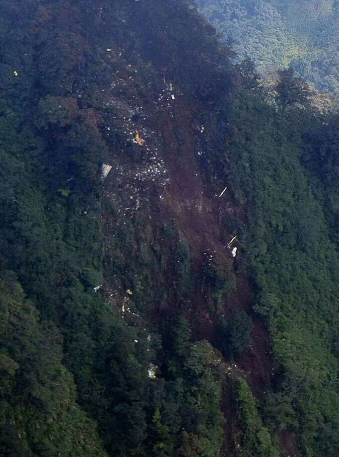 In this picture released by Indonesian Air Force,  the wreckage of a missing Sukhoi Superjet-100 are scattered on the mountainside in Bogor, West Java, Indonesia, Thursday. The new Russian-made passenger plane disappeared Wednesday during a demonstration flight with 47 people on board. Photo: AP