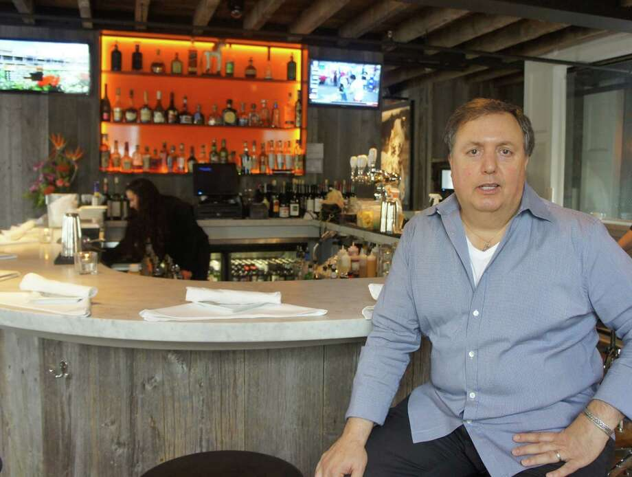 Spotted Horse Tavern Co-owner Tommy Febbraio sits at the bar inside the restaurant at 26-28 Church Lane on Saturday, May 5, 2012. Photo: Paul Schott / Westport News