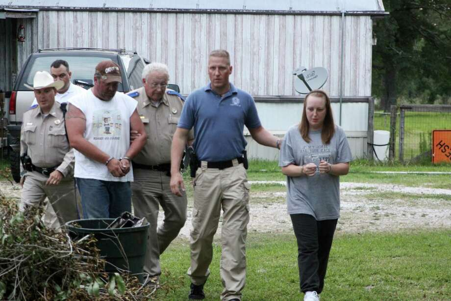 The Hardin County Sheriff's Office confiscated a moonshine still and over 45 gallons of distilled spirits from a home on Harper Lane in Kountze Wednesday evening. Two were arrested and charged one count of possession of illicit distilled spirits and one count of possession of material of manufacture for illicit beverage. Photo: David Lisenby, HCN_Moonshine 2