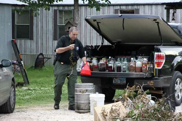The Hardin County Sheriff's Office confiscated a moonshine still and over 45 gallons of distilled spirits from a home on Harper Lane in Kountze Wednesday evening. Two were arrested and charged one count of possession of illicit distilled spirits and one count of possession of material of manufacture for illicit beverage. Photo: David Lisenby, HCN_Moonshine