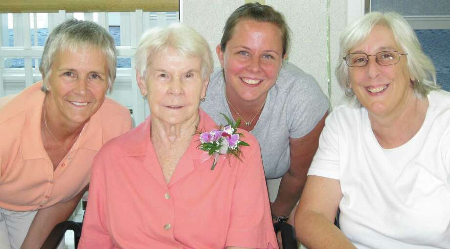 Wearing a corsage, Frances Hines is surrounded by, from left, daughter Janice, granddaughter Sara, and the author. Photo: Contributed Photo / Fairfield Citizen contributed